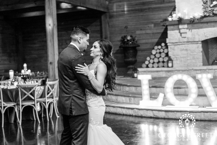 charming bride and groom dance on reception hall