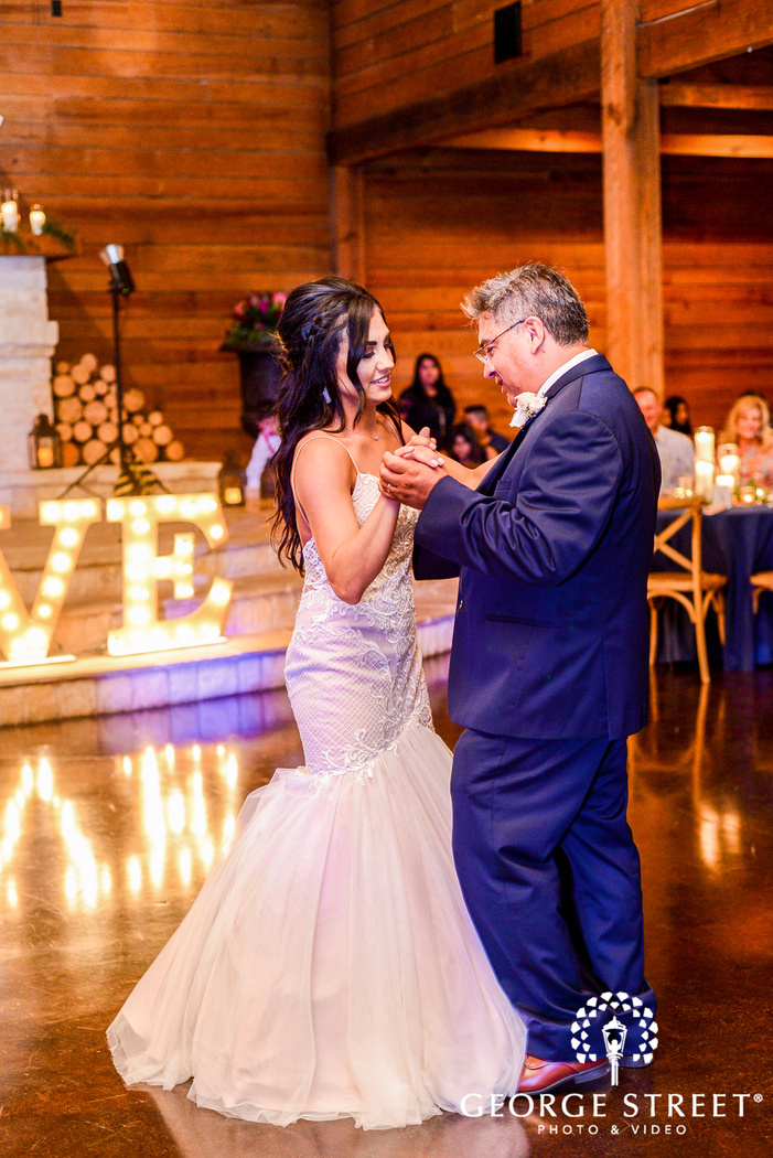 cheery bride and father dance in reception wedding photo
