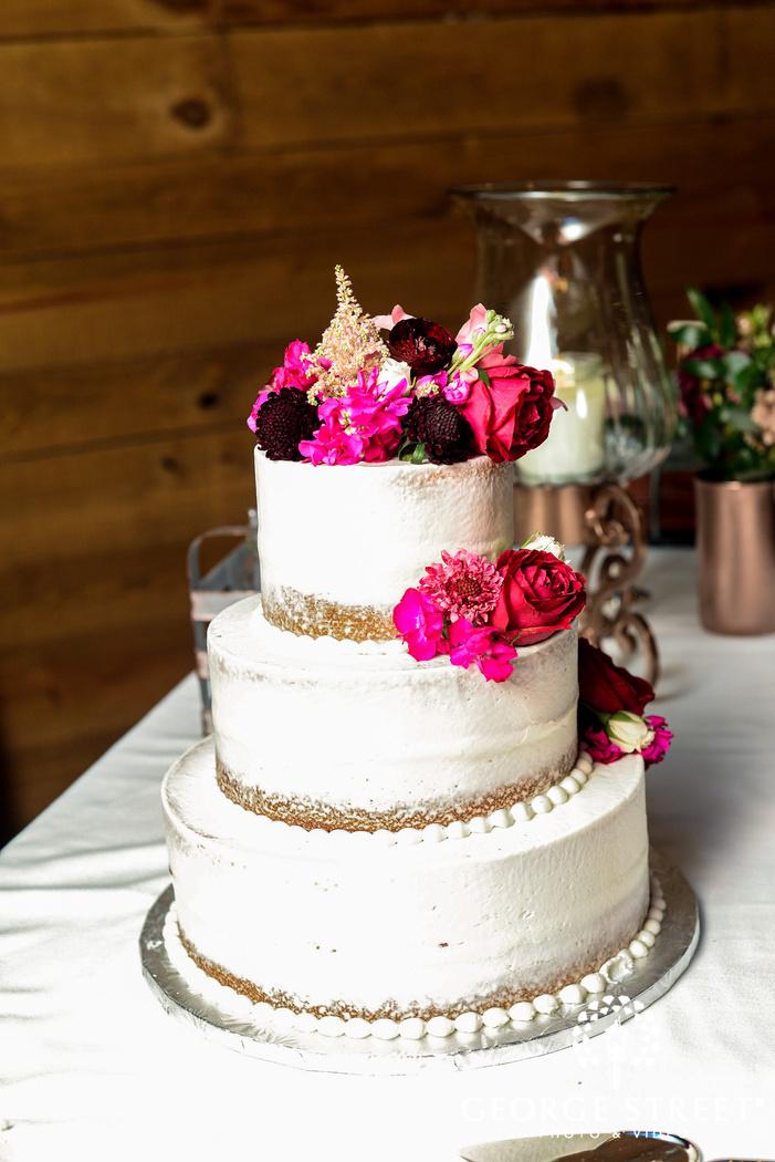 elegant three tier white flower wedding cake wedding photo