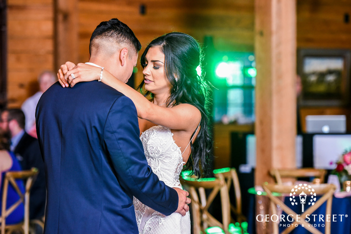 happy bride and groom dance