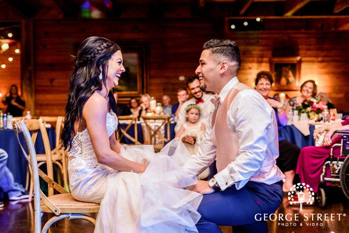 happy bride and groom on reception game wedding photos