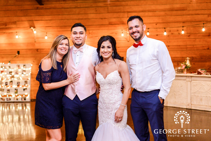 happy bride and groom with friends wedding photos