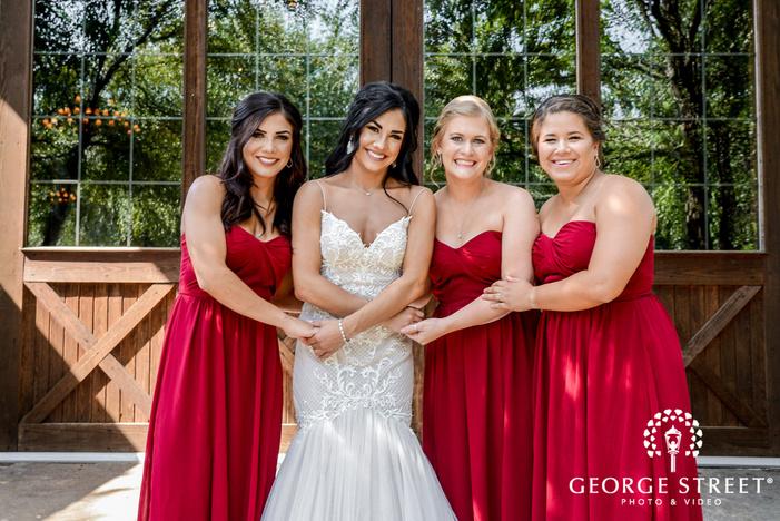 happy bride with friends wedding photos
