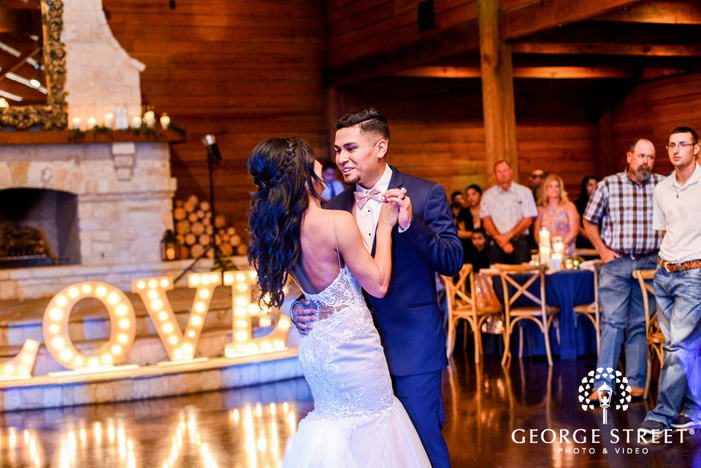 lovable bride and groom dance at classic oaks ranch in dallas   fort worth