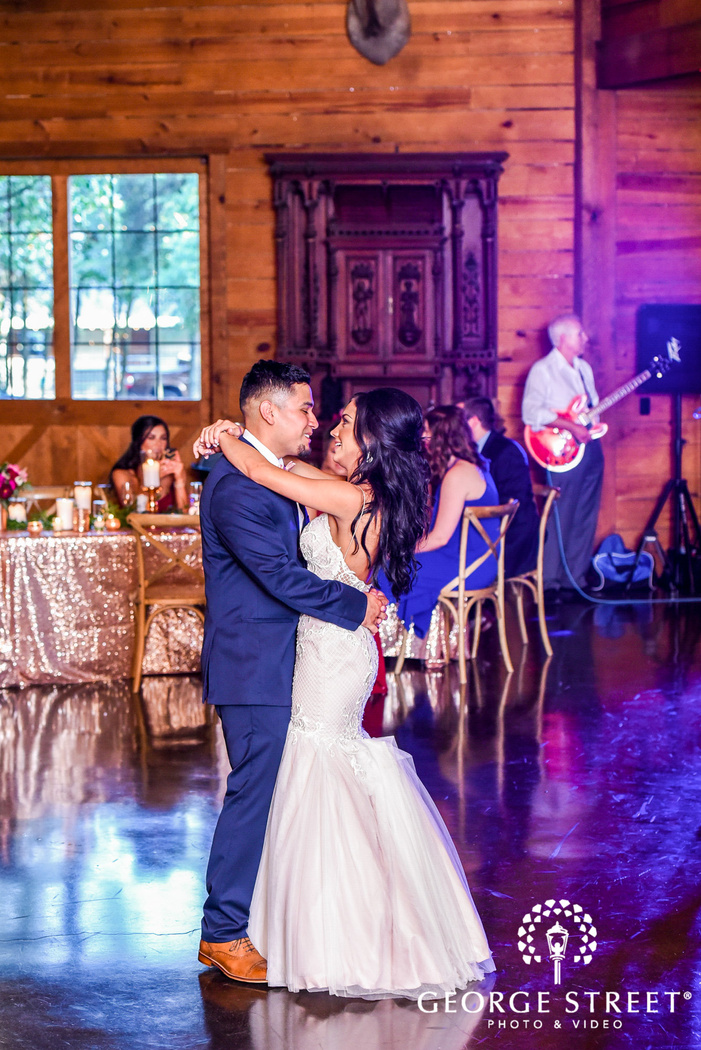 lovely bride and groom dance on reception