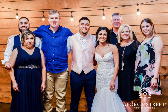 mesmerizing bride and groom with guests wedding photos