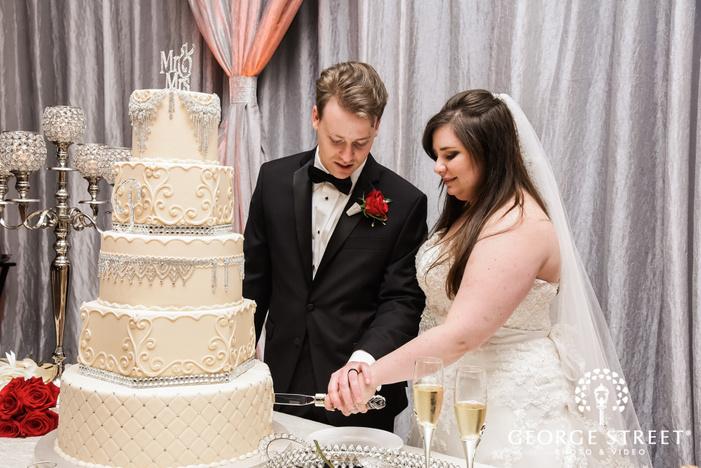bride and groom cake cutting prestonwood country club dallas fort worth wedding photos