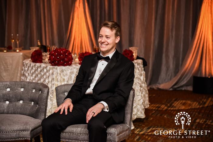 prestonwood country club cheerful groom on sofa dallas fort worth wedding photos
