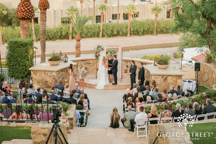 blissful bride and groom wedding vows exchange in ceremony at wrigley mansion in phoenix wedding photos