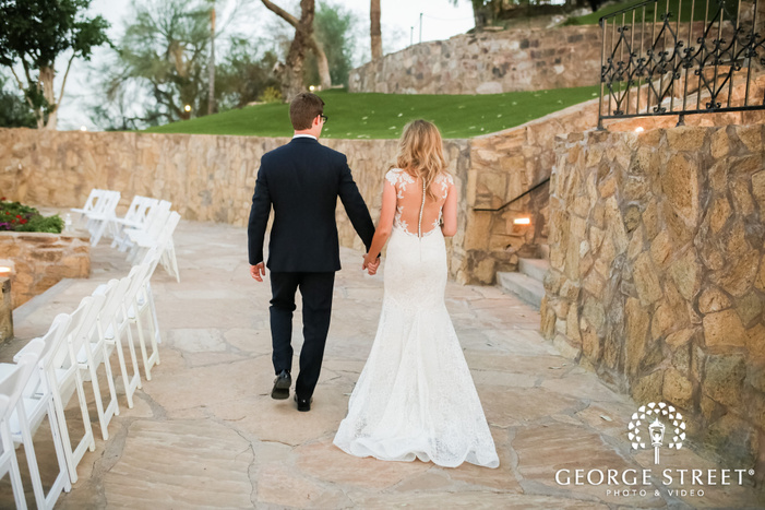 graceful bride and groom on pathway of wrigley mansion wedding photography
