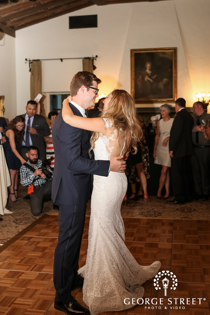 happy bride and groom first dance in reception wedding photo
