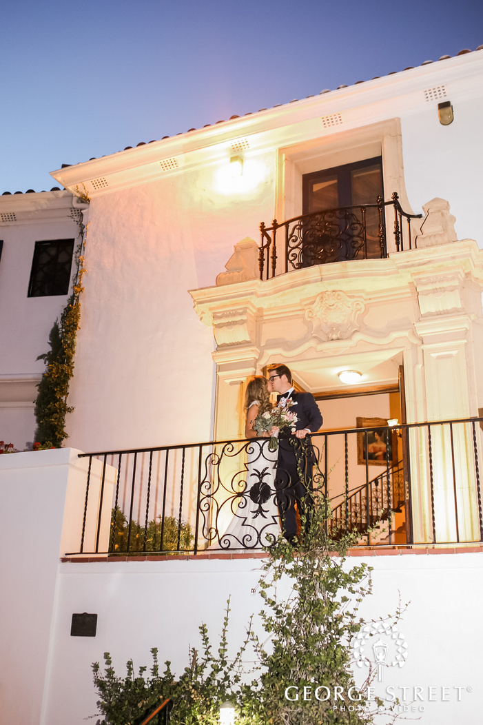 romantic bride and groom at the balcony of wrigley mansion wedding photography