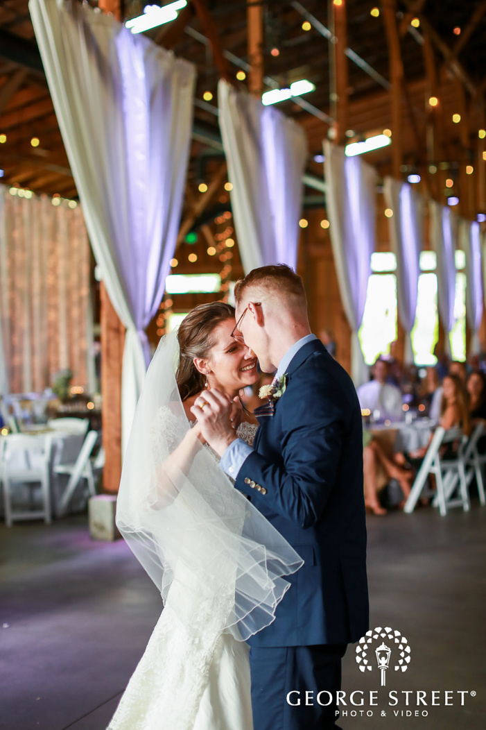 charming bride and groom first dance at thomas family farm in seattle