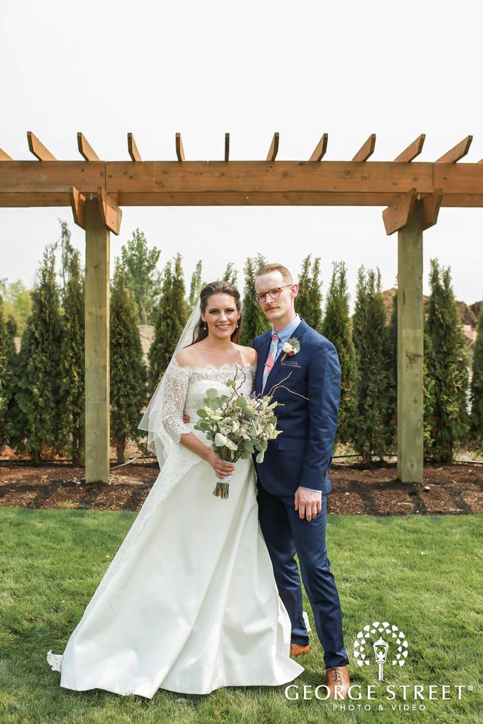 cute bride and groom in garden wedding photography