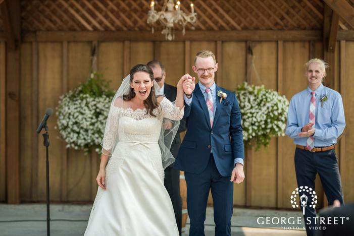 happy bride and groom ceremony exit wedding photos