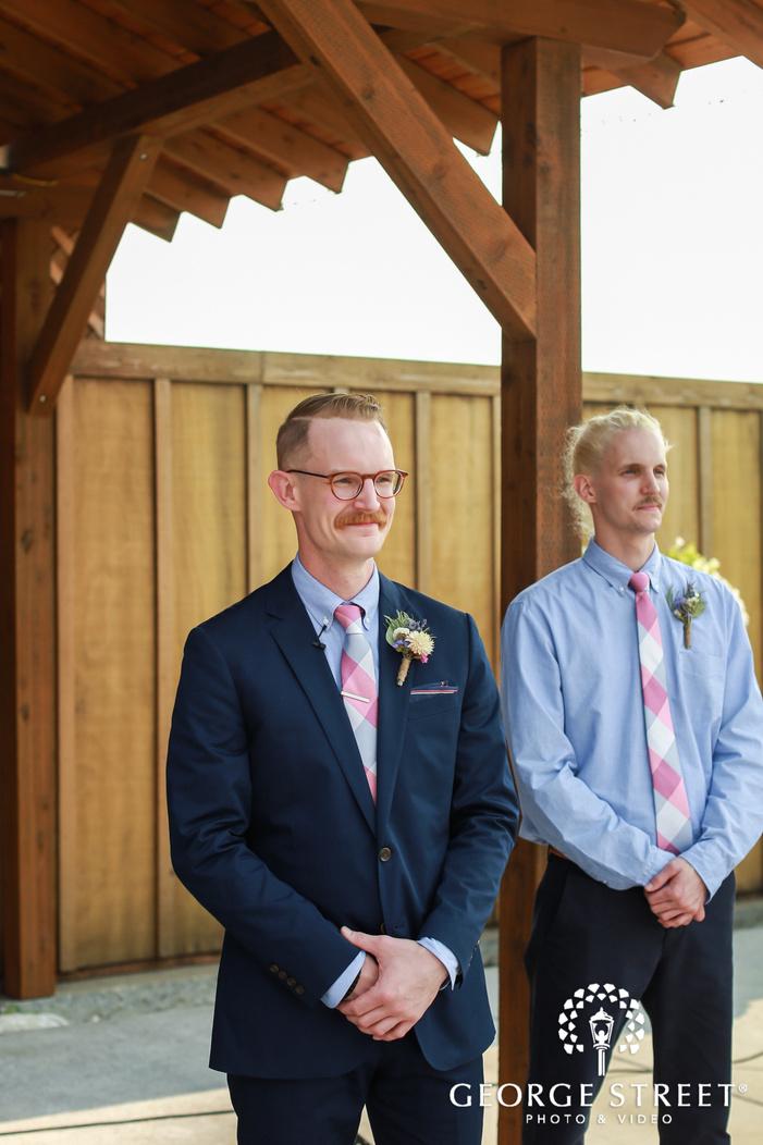happy groom first look wedding photos