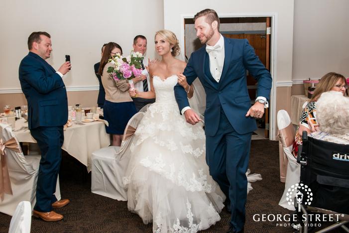 cheerful couple at reception venue wedding photo