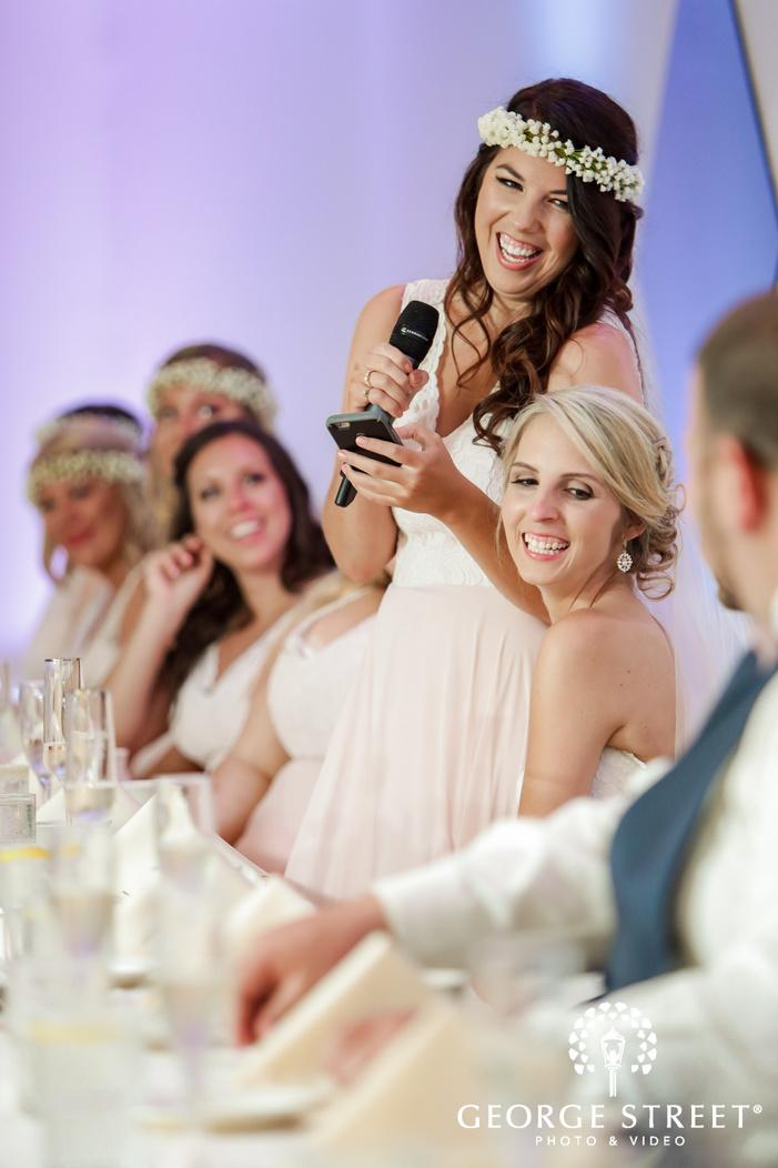 gorgeous couple enjoying wedding speech at reception table