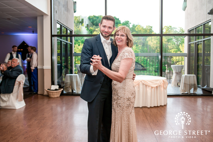 handsome groom and mother dance at georgetown centre in pittsburgh