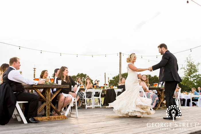 blissful bride and groom first dance at cricket hill ranch in austin