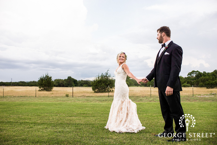 charming bride and groom in lawn at cricket hill ranch in austin
