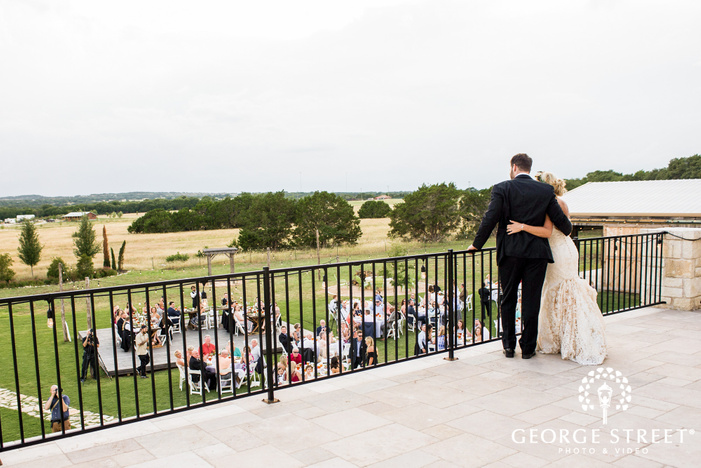 cute bride and groom on balcony at cricket hill ranch in austin