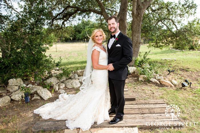 cute bride and groom on garden walkway wedding photography