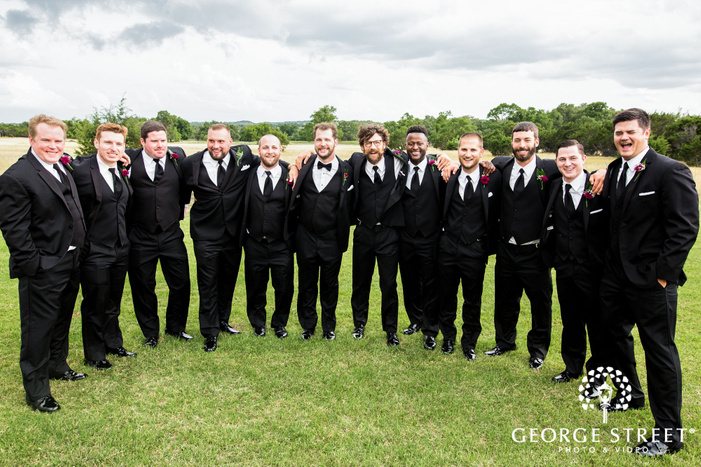 handsome groom and groomsmen in lawn wedding photography