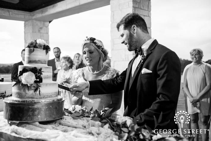 loving bride and groom cake cutting wedding photos