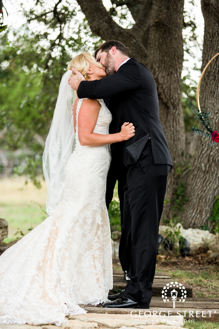 romantic bride and groom first kiss wedding photos